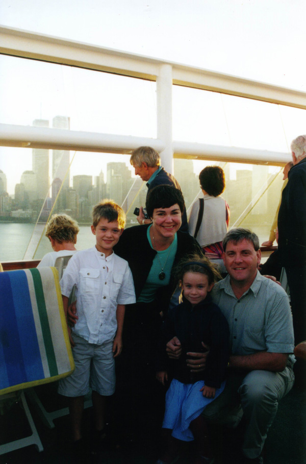 The family on board with the Twin Towers in the background.