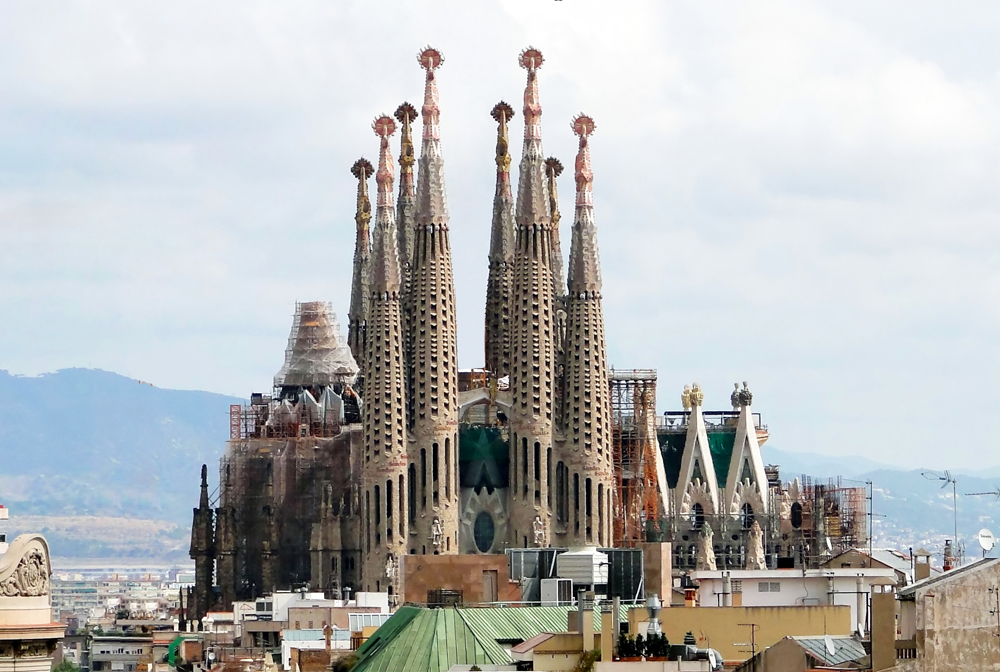 The Sagrada Familia viewed from Casa Milà, Barcelona, Spain. Wikimedia Commons.