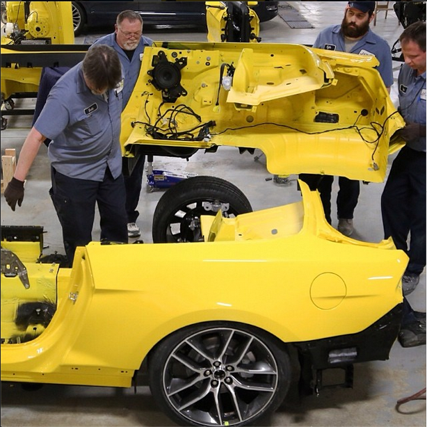 Ford technicians prepare the 2015 Mustang for the Empire State Building elevator.